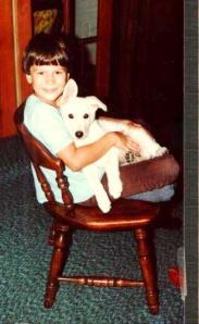 "Brad was sort of a St. Francis type of guy as he loved animals and had many pets. Here he is holding our albino runaway dog, ""Duchess""."