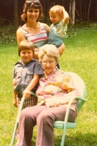With Grandma Johanna, brother and mom in Grandma's backyard.