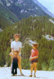 Standing at the foot of the Rockies with me and his brother, age 3.